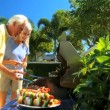 Mature Couple Cooking Healthy Food Outdoors — Stock Video