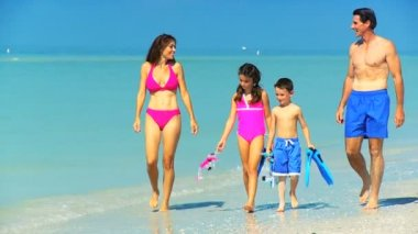 Young Family on the Beach in Swimwear — Stock Video