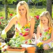 Blonde Mom & Daughter Gardening - Stock Photo
