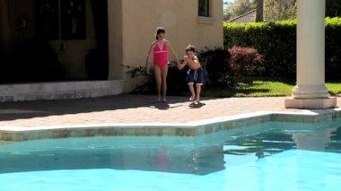 Caucasian Siblings Enjoying the Swimming Pool — Stock Video