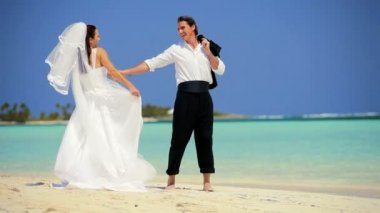 Wedding Couple Laughing & Dancing on the Beach — Stock Video