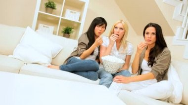 Multi-Ethnic Girlfriends Watching Scary Movie with Popcorn — Stock Video