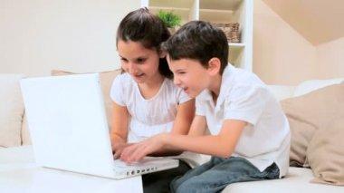 Caucasian Children Using Laptop at Home — Stock Video