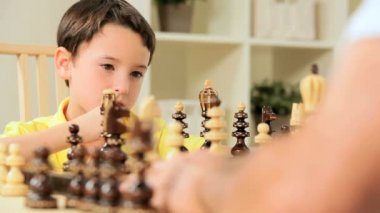 Young Caucasian Boy Playing Chess — Stock Video