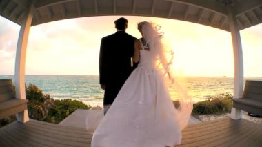 Wide-angle View of Sunset Wedding Couple — Stock Video