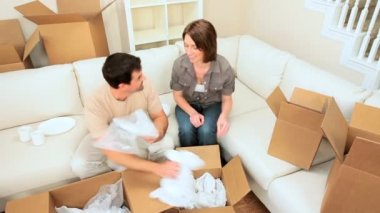 Couple Having Fun with Moving Home Wrappings — Stock Video