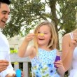 Multi-Ethnic Family Fun Blowing Soap Bubbles — Stock Video