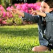 Royalty-Free Stock Vektorfiler: Female Child in Garden with Play Bubbles
