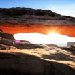 Stock Video: Desert Sunrise Through the Mesa Arch