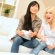 Stock Video: Multi-Ethnic Female Friends Playing Electronic Games