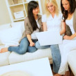 Royalty-Free Stock Vectorielle: Girlfriends Using Laptop at Home