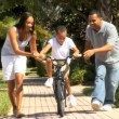Royalty-Free Stock Obraz wektorowy: Parents Teaching Son to Ride Bicycle