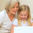 Loving Grandma with Grandchild Playing on Laptop — Stock Video