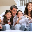 Stock Video: Family Enjoying Games Console