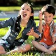 Stock Video: Two Children Outdoors with Play Bubbles