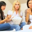 Stock Video: Girlfriends Enjoying Popcorn & a Movie