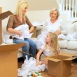 Family Females Playing with Tissue from Moving Cartons — Stock Video