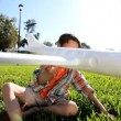 Caucasian Boys Flying Dreams with Homemade Glider - Stockfoto