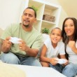 Stock Video: Ethnic Family Competing on Games Console