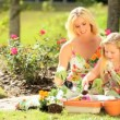 Blonde Mom & Daughter Gardening Together — Stock Video