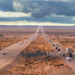Time-lapse Traffic on Desert Highway - Stock Photo