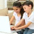 Stock Video: Children Playing Games on Laptop