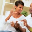 Ethnic Couple Having Fun with Games Console - Stockfoto