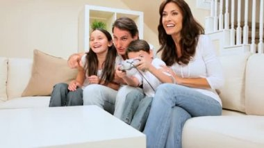Family Encouraging Son on Games Console — Stock Video