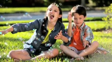 Two Children Outdoors with Play Bubbles — Stock Video