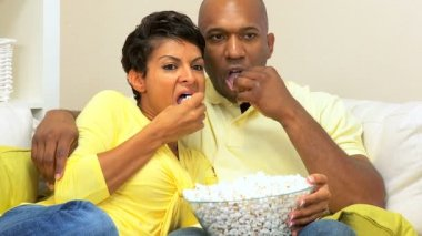 Ethnic Couple Watching Scary Movie with Popcorn — Stock Video