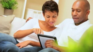 African-American Couple Using Wireless Tablet — Stock Video