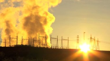 Steam at Sunrise From Energy Production Plant — Stock Video