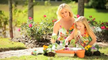 Blonde Mom & Daughter Gardening Together — Stockvideo