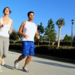 Healthy Couple Jogging Exercise - Stock Photo