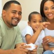 Stock Video: Ethnic Family Playing on Games Console