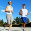 Young Couple Enjoying Jogging Exercise - Stock Photo