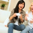 Stock Video: Multi-Ethnic Girlfriends Playing on Games Console