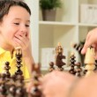 Young Boy Playing Chess with Father — Stock Video