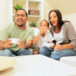 African-American Family Playing on Games Console - Stock Photo