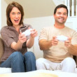 Young Caucasian Couple Playing Electronic Games — Stock Video