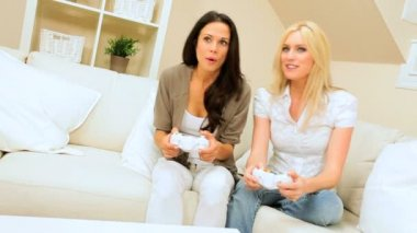 Two Girlfriends Having Fun on Games Console — Stock Video