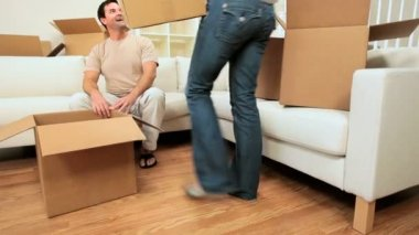 Young Couple Unpacking House Moving Cartons — Stock Video