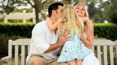Little Blonde Girl & Multi-Ethnic Parents — Stock Video