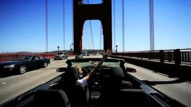 Female Carefree Driving on Golden Gate Bridge — Stock Video