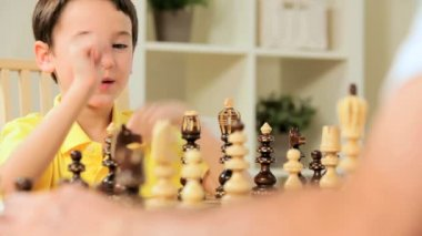 Young Caucasian Boy Playing Chess Game — Stock Video