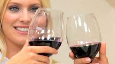 Close-up of Blonde Female Toasting Friends with Wineglass — Stock Video