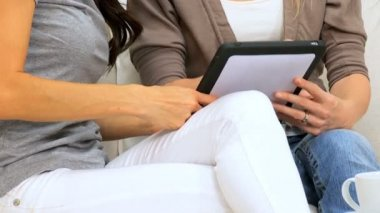 Girlfiends in Close-up with Wireless Tablet — Stock Video