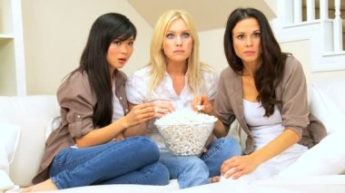 Girlfriends with Popcorn Watching Scary Movie — Stock Video