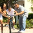 Young African-American Boy Riding on his Bicycle — Stock Video #23180990