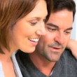 Portrait of Relieved Young Couple - Stock Photo